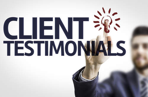 Business man pointing to client testimonials
