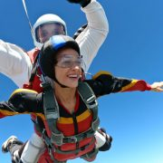 Woman and Man skydiving in tandem